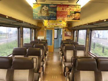 今は数少ない、JR北海道 函館本線の対面座席のある車内にて